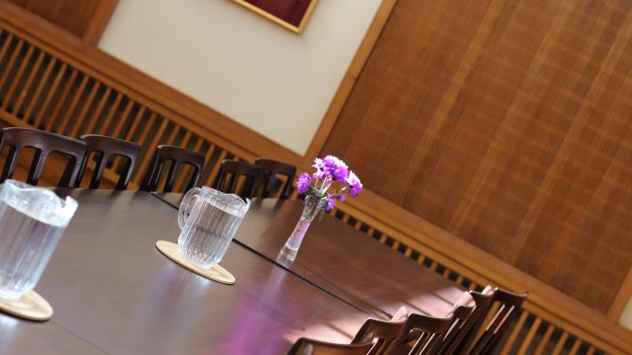 Table and flowers in dining hall