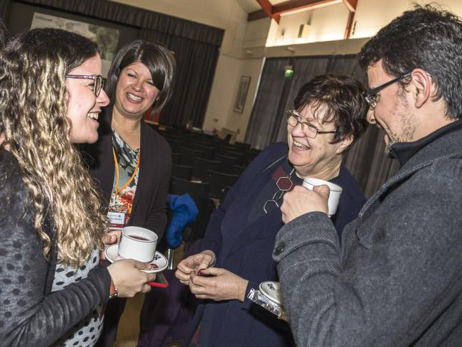 Jane Clarke laughing with international students