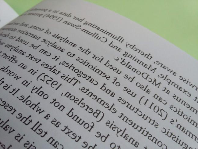 close-up of book showing in-text references
