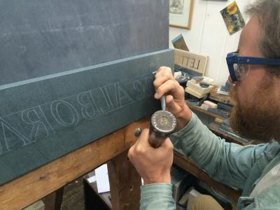 Carving the Alborada slate sign