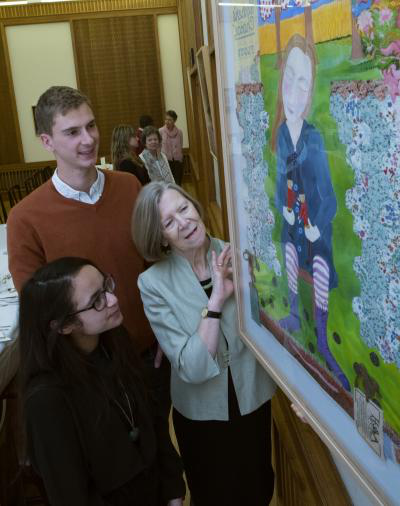 Margaret Greeves showing art to students